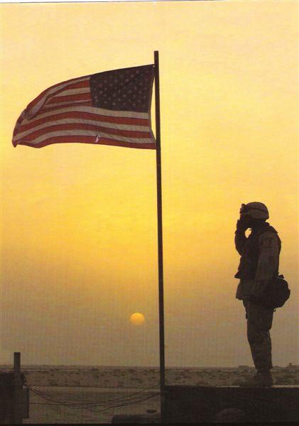 soldieriniraqsalutesflag.jpg